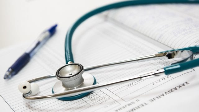 Pen and stethoscope on medicare advantage enrollment plan