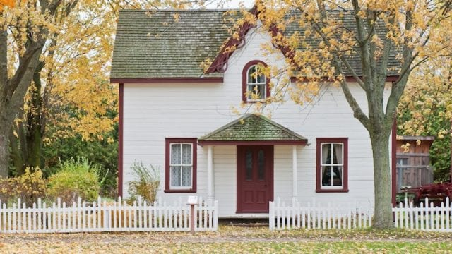 Front view of home with white picket fence