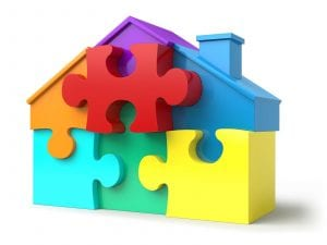 multi-colored puzzle piece home